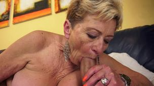 aged granny kissing sofa tits